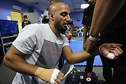 """Egyptian boxing champion Hisham Hiba getting hamds dressed before fight in Blue corner locker room<br /><br />MMA. Mixed Martial Arts """"Tigers of Asia"""" cage fighting competition. Top professional male and female fighters from across Asia, Russia, Australia, Malaysia, Japan and the Philippines come together to fight. This tournament takes place in front of a ten thousand strong crowd of supporters in Pelaing Stadium. Kuala Lumpur, Malaysia. October 2015"""