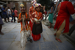 August 8, 2017 - Kathmandu, Nepal - Nepalese children dressed in traditional attire react as they take part in a procession to celebrate Gai Jatra or Cow Festival in Basantapur, Kathmandu, Nepal on Tuesday, August 8, 2017. People from the Newar community commemorate the festival to wish peace for their deceased family members from preceding years. (Credit Image: © Skanda Gautam via ZUMA Wire)