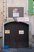 Tabac tobacco shop, Chateau Petit Alain, La cave a vin, the wine cellar. La Liquiere village. Faugeres. Languedoc. A door. France. Europe.
