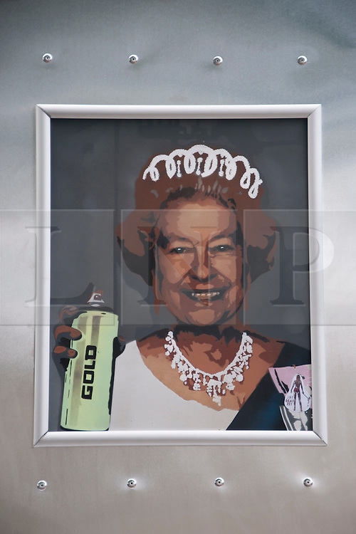 © Licensed to London News Pictures. 04/06/2012. Bristol, UK. Portrait of the queen in the front window of a New York subway carrage at Upfest, Europe's largest urban art festival, during The Royal Jubilee celebrations. Great Britain is celebrating the 60th  anniversary of the countries Monarch HRH Queen Elizabeth II accession to the throne this weekend Photo credit :David Mirzoeff/ LNP