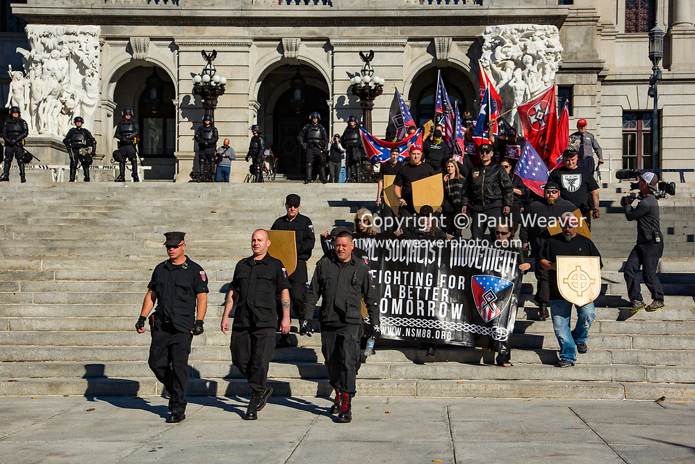 Harrisburg, PA -- Several dozen white supremacists from the National Socialist Movement (NSM), the Traditionalist Worker PArty (TWP), the Texas Rebel Knights of the Ku Klux Klan, and Arthur Jones of the America First Committee parade down the steps of the Pennsylvania State Capitol.