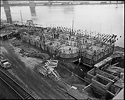 "Ackroyd 05924-1. ""Balfour - Guthrie."" close-up aerials of grain elevator construction. March 14, 1955 4x5"""