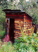 Little one-holer outhouse, living ghost town of Keno City, Yukon Territory, Canada.