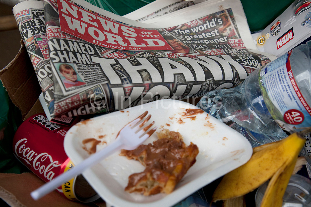 "The last ever copy of tabliod newspaper News of The World in the cart of a street cleaner as someone throws in more rubbish. Sunday 10th July 2011 saw the end for this most famous of newspapers. Embroiled in the phone hacking scandal, this News International paper had approximately 7 million readers at the time of it's demise. On the cover of this, the final edition, with examples of previous journalistic success the headline simply read ""Thank You & Goodbye""."