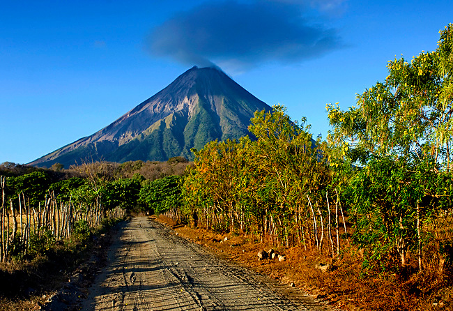 The active Concepcion Volcano dominates the rural landscape on the Island of Ometepe, an island formed by two volcanoes<br /> rising from Lake Nicaragua.  The island has been declared a UNESCO Biosphere Preserve.