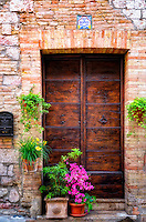 """Beautiful flowers and Pax et bonum adorn the doors of Assisi""…<br />