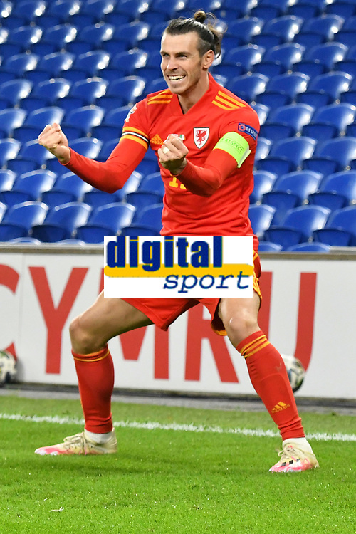 Football - 2020/2021 UEFA Nations League - Group B4 - Wales vs Republic of Ireland - Cardiff City Stadium<br /> <br /> Gareth Bale of Wales celebrates Wales' 1st goal scored by David Brooks of Wales<br /> in a match played without fans<br /> <br /> COLORSPORT/WINSTON BYNORTH