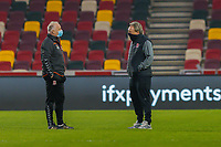Football - 2020 /2021 Emirates FA Cup - Third Round: Brentford vs. Middlesbrough <br />  -  Brentford Community Stadium<br /> <br /> Neil Warnock, Manager of Middlesborough FC,  speaks with a member of his coaching team ahead of fielding a weakened Middlesbrough team against Brentford<br /> <br /> COLORSPORT/DANIEL BEARHAM