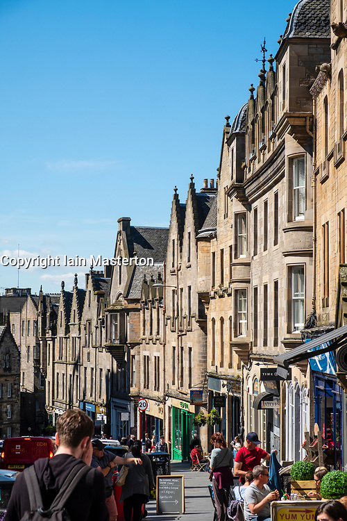 View of shops and cafes  on historic Cockburn Street in Old Town of Edinburgh, Scotland, UK