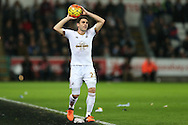 Angel Rangel of Swansea city takes a throw-in. Barclays Premier league match, Swansea city v West Bromwich Albion at the Liberty Stadium in Swansea, South Wales  on Boxing Day Saturday 26th December 2015.<br /> pic by  Andrew Orchard, Andrew Orchard sports photography.