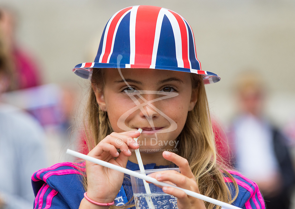 Trafalgar Square, London, June 12th 2016. Rain greets Londoners and visitors to the capital's Trafalgar Square as the Mayor hosts a Patron's Lunch in celebration of The Queen's 90th birthday. PICTURED: Darcey Carr, 10 from Broadstairs enjoys the goings-on in Trafalgar Square.