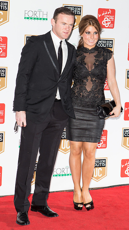© Licensed to London News Pictures . 27/03/2014 . Manchester , UK . Wayne Rooney and Coleen Rooney arrive at a gala dinner at Manchester United Football Club in support of United for Colitis , in aid of Crohn's And Colitis UK . Photo credit : LNP