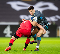 Tiaan Thomas-Wheeler of Ospreys is tackled by Jack Singleton of Saracens<br /> <br /> Photographer Simon King/Replay Images<br /> <br /> European Rugby Champions Cup Round 5 - Ospreys v Saracens - Saturday 11th January 2020 - Liberty Stadium - Swansea<br /> <br /> World Copyright © Replay Images . All rights reserved. info@replayimages.co.uk - http://replayimages.co.uk