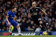 Riyad Mahrez of Leicester City (R) in action with Cesc Fabregas of Chelsea (L). Premier League match, Chelsea v Leicester City at Stamford Bridge in London on Saturday 13th January 2018.<br /> pic by Steffan Bowen, Andrew Orchard sports photography.