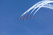 Canadian Forces Snowbirds in a Big Diamond formation complete a loop with smoke.  The Snowbirds are also known as the 431 Air Demonstration Squadron and fly the Canadair CT-114 Tutor jet. Photographed during the Canada 150 celebrations in White Rock, British Columbia, Canada.