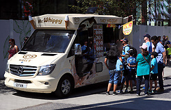 Manchester City fans queue at an ice cream van before the Community Shield match at Wembley Stadium, London.