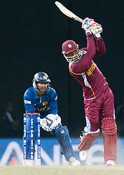 © Licensed to London News Pictures. 07/10/2012. West Indian Marlon Samuels batting during the World T20 Cricket Mens Final match between Sri Lanka Vs West Indies at the R Premadasa International Cricket Stadium, Colombo. Photo credit : Asanka Brendon Ratnayake/LNP
