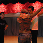 Champion opposite sex dancer and instructor Diana McDonald, center, coaches same-sex dancers Jean-Francois Fortin, left, of Montreal, Canada and Willem Alexander, of Jersey City in the paso doble at Rogers DanceSport Center International in Fairfield, New Jersey on April 27, 2007, in preparation for the couples' participation in the 5 Boro Dance Challenge same-sex ballroom dance competition. ..The locally produced 5 Boro Dance Challenge, New York City's first same-sex dance competition, was held at the Park Central Hotel in Manhattan from May 4-6, 2007. ..Fortin and Alexander placed second in the men?s latin A categroy and won the paso doble in the competition...