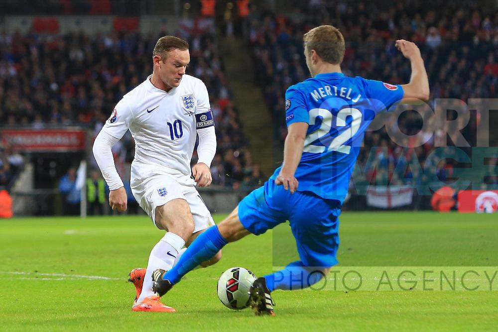 Ales Mertelj of Slovenia tackles Wayne Rooney of England - England vs. Slovenia - UEFA Euro 2016 Qualifying - Wembley Stadium - London - 15/11/2014 Pic Philip Oldham/Sportimage