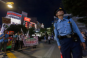 A small protest against the staging of the Olympic Games in Shinjuku, Tokyo, Japan Friday June 30th 2017. Though mostly popular with the Japanese population he staging of the 2020 Olympic Games in Tokyo is felt by some to be a waste of money when the economy is bad, causing increasing poverty rates and with problems in the Tsunami damaged North East coast still not fully resolved.