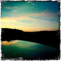 2013 March 10:  Malibu Winery location wine art.  Pool sunset reflection.  Malibu Canyon.  iPhone Hipsta