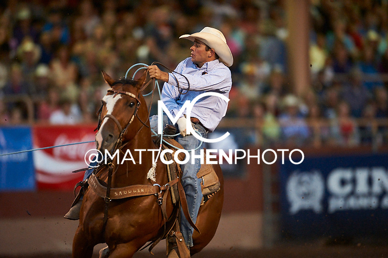 Team roper Tyler Schaufer of Pueblo, CO competes at the Pikes Peak or Bust Rodeo in Colorado Springs, CO.<br /> <br /> <br /> UNEDITED LOW-RES PREVIEW<br /> <br /> <br /> File shown may be an unedited low resolution version used as a proof only. All prints are 100% guaranteed for quality. Sizes 8x10+ come with a version for personal social media. I am currently not selling downloads for commercial/brand use.