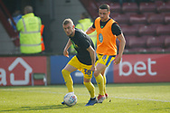 Wimbledon Shane McLoughlin (38) and Wimbledon midfielder Anthony Hartigan (8)  warming up during the EFL Sky Bet League 1 match between Scunthorpe United and AFC Wimbledon at Glanford Park, Scunthorpe, England on 30 March 2019.