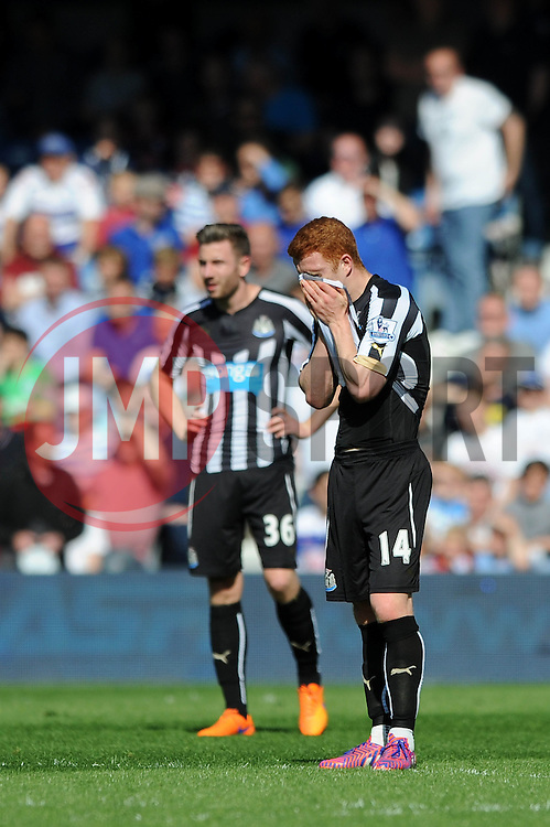 Newcastle United's Jack Colback cuts a dejected figure  - Photo mandatory by-line: Dougie Allward/JMP - Mobile: 07966 386802 - 16/05/2015 - SPORT - football - London - Loftus Road - QPR v Newcastle United - Barclays Premier League