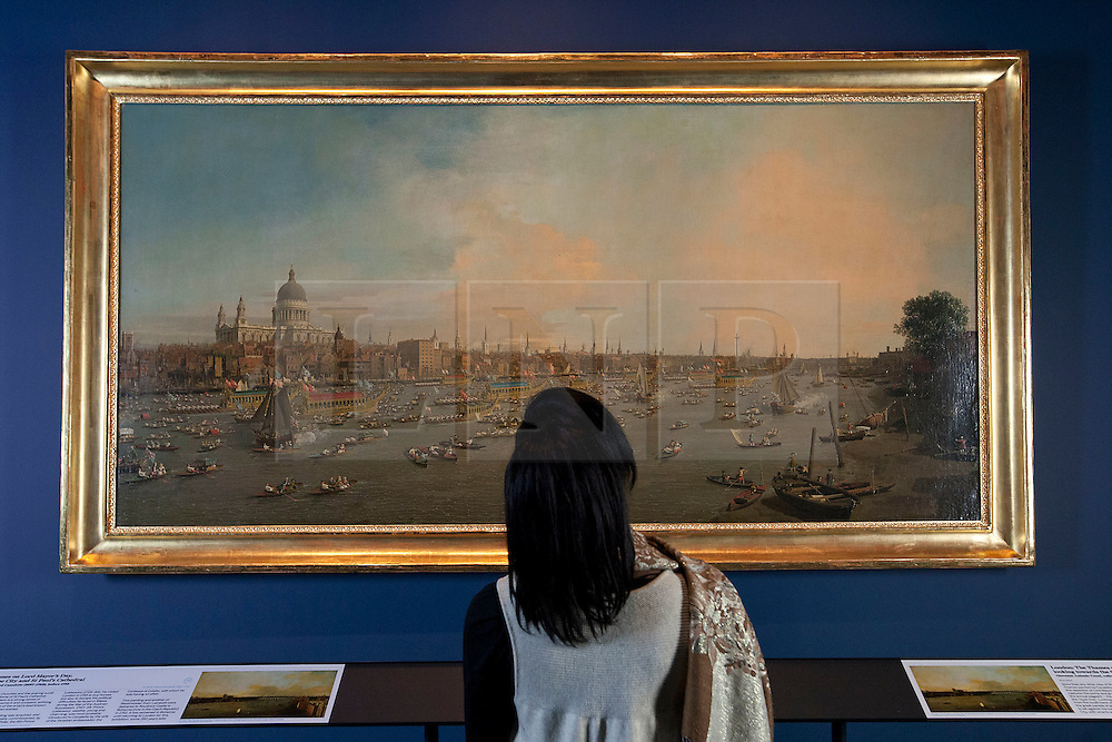 © Licensed to London News Pictures. 20/04/2012. LONDON, UK. An art fan views Canalettos London: The Thames on Lord Mayor's Day in the National Maritime Museum.  The painting, depicting a view looking towards the City and St Pauls Cathedral has been cited as one of the inspirations for the Thames Diamond Jubilee Pageant and goes on show at the National Maritime Museums forthcoming Royal River: Power, Pageantry & the Thames exhibition in Greenwich from the 27th of April. Photo credit: Matt Cetti-Roberts/LNP