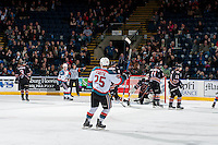 KELOWNA, CANADA - FEBRUARY 1: Kole Lind #16 and Cal Foote #25 of the Kelowna Rockets celebrate a second period goal against the Calgary Hitmen on February 1, 2017 at Prospera Place in Kelowna, British Columbia, Canada.  (Photo by Marissa Baecker/Shoot the Breeze)  *** Local Caption ***
