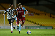 Lewis Spence (20) of Scunthorpe United David Worrall (7) of Port Vale battles for possession during the EFL Sky Bet League 2 match between Port Vale and Scunthorpe United at Vale Park, Burslem, England on 17 November 2020.