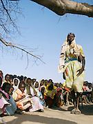 A school teacher and her class in the Nuba tribe village of Nyaro, Kordofan region, Sudan