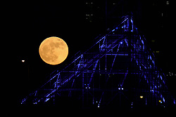 The Wolf Moon rises behind the Convention Center in Portland, Ore., on January 1, 2018. It is first of two super moons for the month and according to NASA it is the biggest and brightest of the year. (Photo by Alex Milan Tracy/Sipa USA)