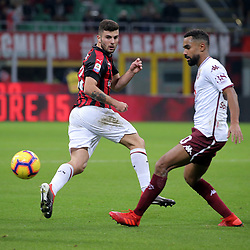 December 9, 2018 - Milan, Milan, Italy - Patrick Cutrone #63 of AC Milan competes for the ball with Koffi Djidji #30 of Torino FC during the serie A match between AC Milan and Torino FC at Stadio Giuseppe Meazza on December 09, 2018 in Milan, Italy. (Credit Image: © Giuseppe Cottini/NurPhoto via ZUMA Press)