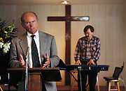 "New Life church, Silicon Valley, California; Larry Wall, author of the computer language ""Pearl"" and musician, at the New Life Church in Cupertino, California, plays the electric organ during a service. Wall references the music via his laptop computer, which accesses the Internet over a wireless modem. He also has the bible on his laptop. Model Released (1998)."