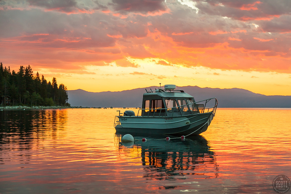 """""""Fishing Boat on Lake Tahoe 6"""" - Photograph of a buoyed fishing boat on Lake Tahoe at sunrise. Shot during the annual Jakes on the Lake charity fishing derby."""