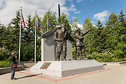A tourist views the Lend Lease Monument in downtown riverfront park in Fairbanks, Alaska. The statue depicts Russian and American WWII pilots, commemorating Alaska as the staging ground in the Lend-Lease program which provided nearly 8,000 aircraft to the eastern front.