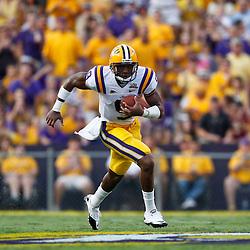 Sep 18, 2010; Baton Rouge, LA, USA; LSU Tigers quarterback Jordan Jefferson (9) runs against the Mississippi State Bulldogs during the first half at Tiger Stadium.  Mandatory Credit: Derick E. Hingle