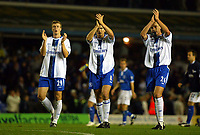 Photograph: Scott Heavey.<br />Birmingham v Chelsea. 14/10/2003. FA Barclaycard Premiership.<br />A disappointed trio of Robert Huth (Left) Frank Lampard (middle) and John Terry applaud the travelling Chelsea fans.