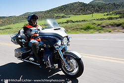 Check Roundy of Larkspur, CO on his 2016 CVO Ultra Limited riding from Steamboat Springs to Doc Holliday's Harley-Davidson in Glenwood Springs during the Rocky Mountain Regional HOG Rally, Colorado, USA. Thursday June 8, 2017. Photography ©2017 Michael Lichter.