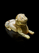 Phrygian ivory statuette carved as a roaring lion lying down from a table base decoration. From Gordion. Phrygian Collection, 8th-7th century BC - Museum of Anatolian Civilisations Ankara. Turkey. Against a black background .<br /> <br /> If you prefer you can also buy from our ALAMY PHOTO LIBRARY  Collection visit : https://www.alamy.com/portfolio/paul-williams-funkystock/phrygian-antiquities.html  - Type into the LOWER SEARCH WITHIN GALLERY box to refine search by adding background colour, place, museum etc<br /> <br /> Visit our CLASSICAL WORLD PHOTO COLLECTIONS for more photos to download or buy as wall art prints https://funkystock.photoshelter.com/gallery-collection/Classical-Era-Historic-Sites-Archaeological-Sites-Pictures-Images/C0000g4bSGiDL9rw