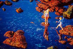 children explore tide pools at sunset, La Jolla, San Diego, California, East Pacific Ocean