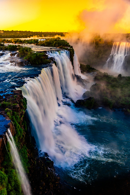 Iguazu Falls (Iguacu in Portugese), on the border of Brazil and Argentina. It is one of the New 7 Wonders of Nature. There are 275 waterfalls total which make up the largest waterfalls in the world. This photo is on the Brazil side of the Falls.