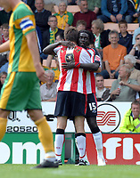 Photo: Ashley Pickering.<br /> Norwich City v Southampton. Coca Cola Championship. 18/08/2007.<br /> Kenwyne Jones (no. 15) celebrates his opener for Southampton with team mate Grzegorz Rasiak
