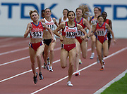 Tatyana Tomashova of Russia overtakes Sureyya Ayhan of Turkey to win the 1,500 meters in a championship record 3:58.52 in the IAAF World Championships in Athletics at Stade de France on Sunday, Aug. 31, 2003. Ayhan was second in 3:59.04.