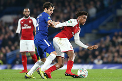10 January 2018 - Football League Cup - Chelsea v Arsenal - Cesc Fabregas of Chelsea and Alex Iwobi of Arsenal battle for the ball - Photo: Charlotte Wilson / Offside
