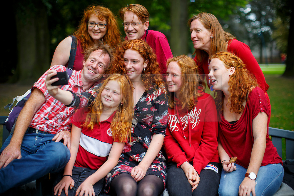 © Licensed to London News Pictures. 04/09/2016. Breda, The Netherlands. A family pose for a picture as thousands of redheads fill a Dutch city Breda to celebrate International Redhead Day event in The Netherlands on Sunday, 4 September 2016. Every year natural redheads from more than 80 countries come together at 'Roodharigendag' annual weekend long festival to celebrate their ginger genes. The event also holds the world record for the largest number of natural redheads being in one place. Photo credit: Tolga Akmen/LNP