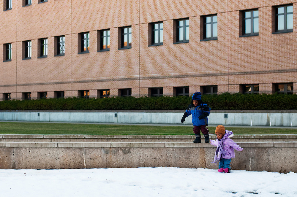 Matt Dixon | The Flint Journal..3-year-olds from a preschool class at the Early Childhood Development Center enjoy the nice weather by exploring the campus of University of Michigan-Flint, Friday, Feb. 18.