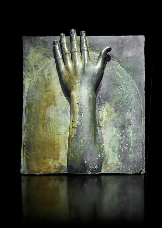 Roman decoration panels that covered the end of the beams from a Roman ship, from the age of Calligula, 37-41 AD, made from bronze. The forearms were used to ward off evil the extended gesture was meant to keep danger away.  The National Roman Museum, Rome, Italy
