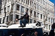 Roma 23 febbraio 2011.Manifestazione contro i Stati Generali del Comune di Roma organizzato dal Comitato Roma Bene Comune. Un manifestante mascherato sale su un blindato dei carabinieri.Rome 23 February 2011.Demonstration against the States-General of the Municipality of Rome organized by the Committee Rome Common Good.
